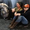Joe Brook and Danielle Moser wait to be able to check in for a flight to Portland as an Alaska Airlines computer problem delays flights across its 64-airport network on the West Coast and in Mexico and Canada Monday, Oct. 8, 2012 at Ted Stevens Anchorage International Airport. (AP Photo/Anchorage Daily News, Erik Hill)