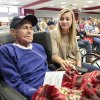 Photo - Bayley Allen, right, from Noble High School, holds the hand of World War II veteran James Brown during the