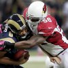 St. Louis Rams quarterback Sam Bradford, left, is sacked by Arizona Cardinals inside linebacker Daryl Washington during the second quarter of an NFL football game, Thursday, Oct. 4, 2012, in St. Louis. (AP Photo/Tom Gannam)