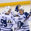 Toronto Maple Leafs\' Mika Grabovski, second from right, celebrates his first-period goal against the Ottawa Senators with teammates Korbinian Holzer, left to right, Dion Phaneuf, and Nikolai Kulemin during an NHL hockey game in Ottawa, Ontario, on Saturday, Feb. 23, 2013. (AP Photo/The Canadian Press, Sean Kilpatrick)