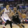 Brooklyn Nets\' Alan Anderson, right, drives past Los Angeles Clippers\' Matt Barnes during the second half of an NBA basketball game on Saturday, Nov. 16, 2013, in Los Angeles. (AP Photo/Jae C. Hong)