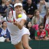 Photo - Ekaterina Makarova of Russia plays a return to Agnieszka Radwanska of Poland during their women's singles match at the All England Lawn Tennis Championships in Wimbledon, London, Monday, June 30, 2014. (AP Photo/Sang Tan)