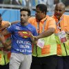 Photo - Stewards apprehend a man who ran onto the pitch during the World Cup round of 16 soccer match between Belgium and the USA at the Arena Fonte Nova in Salvador, Brazil, Tuesday, July 1, 2014. (AP Photo/Matt Dunham)