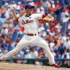Photo - Philadelphia Phillies' David Buchanan pitches during the third inning of a baseball game against the New York Mets, Monday, Aug. 11, 2014, in Philadelphia. (AP Photo/Matt Slocum)