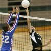 OBA\'s Whitney Maple (right) tips the ball over toward CHA opponent Lindsey LittleJim during the Class 4A Girls State Volleyball Championship between the Oklahoma Bible Academy Lady Trojans and the Christian Heritage Academy Crusaders at Edmond Santa Fe High School in Edmond, OK, Friday, Oct. 9, 2009. By Paul Hellstern, The Oklahoman