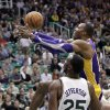 Los Angeles Lakers center Dwight Howard (12) drives to the basket as Utah Jazz center Al Jefferson (25) watches during the first quarter of an NBA basketball game Wednesday, Nov. 7, 2012, in Salt Lake City. (AP Photo/Rick Bowmer)