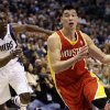 Photo - Houston Rockets guard Jeremy Lin (7) drives by Dallas Mavericks' Darren Collison (4) in the first half of an NBA basketball game, Wednesday, March 6, 2013, in Dallas. (AP Photo/Tony Gutierrez)