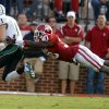 Oklahoma\'s Javon Harris (30) tries to stop Baylor\'s Nick Florence (11) during the college football game between the University of Oklahoma Sooners (OU) and Baylor University Bears (BU) at Gaylord Family - Oklahoma Memorial Stadium on Saturday, Nov. 10, 2012, in Norman, Okla. Photo by Chris Landsberger, The Oklahoman