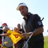 Photo - Graeme McDowell of Northern Ireland signs autographs after putting on the 12th green during a practice round ahead of the British Open Golf championship at the Royal Liverpool golf club, Hoylake, England, Tuesday July 15, 2014. The British Open starts on Thursday July 17. (AP Photo/Jon Super)
