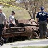 Law enforcement officials from multiple agencies examine the two cars pulled from Foss Lake, in Foss, Okla., Wednesday, Sept. 18, 2013. The Oklahoma State Medical ExaminerÂ's Office says authorities have recovered skeletal remains of multiple bodies in the Oklahoma lake where the cars were recovered. (AP Photo/Sue Ogrocki) ORG XMIT: OKSO101