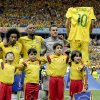 Photo - Brazil's David Luiz, right, holds up Neymar's jersey during team introductions before the World Cup semifinal soccer match between Brazil and Germany at the Mineirao Stadium in Belo Horizonte, Brazil, Tuesday, July 8, 2014. (AP Photo/Natacha Pisarenko)