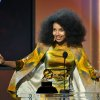 "Photo - Esperanza Spalding accepts the jazz vocal album for ""Radio Music Society"" at the 55th annual Grammy Awards on Sunday, Feb. 10, 2013, in Los Angeles. (Photo by John Shearer/Invision/AP)"