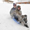 Michael Kuder, 17, of Pleasant Hill, and Luke Cameron, 16, of Troy double up on a sled run at Mote Park in Piqua, Ohio on Thursday, Dec. 27, 2012. (AP Photo/Piqua Daily Call, Mike Ullery)