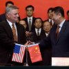 Photo - FILE - In this July 24, 2007 file photo, Stephen Tritch, then president and chief executive of Westinghouse, left, shakes hands with Wang Binghua, chairman of the State Nuclear Power Technology Corp. of China (SNPTC), during a signing ceremony to build nuclear power plants in China, at the Great Hall of the People in Beijing. The Justice Department's indictment last week of five Chinese military officials charged them with trying to pilfer confidential information from American companies. But even some of the alleged U.S. corporate victims of the hackers have little incentive to cheer any trade rupture with China. (AP Photo/Ng Han Guan, Pool, File)