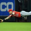 Photo - Los Angeles Angels' Kole Calhoun dives but misses catching a line drive hit by Houston Astros' Jose Altuve in the fourth inning of a baseball game on Friday, April 4, 2014, at Minute Maid Park in Houston. (AP Photo/Eric Christian Smith)