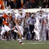 Oklahoma\'s Cameron Kenney (6) scores a long touchdown as Oklahoma State\'s Devin Hedgepeth (18) chases him down during the Bedlam college football game between the University of Oklahoma Sooners (OU) and the Oklahoma State University Cowboys (OSU) at Boone Pickens Stadium in Stillwater, Okla., Saturday, Nov. 27, 2010. Photo by Sarah Phipps, The Oklahoman