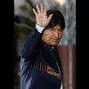 FILE - In this Tuesday, Oct. 2, 2012, Bolivia\'s President Evo Morales waves to photographers upon his arrival to the Summit of South American and Arab Countries in Lima, Peru. Morales said Friday, Oct. 12, 2012, during a ceremony marking