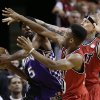 Miami Heat\'s Norris Cole, center, and Chris Andersen pressure Sacramento Kings\' John Salmons (5) during the first half of an NBA basketball game in Miami, Tuesday, Feb. 26, 2013. (AP Photo/J Pat Carter)