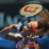 Serena Williams of the US hits a forehand return to Spain\'s Garbine Muguruza during their second round match at the Australian Open tennis championship in Melbourne, Australia, Thursday, Jan. 17, 2013. (AP Photo/Andrew Brownbill)