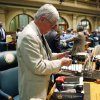 Rep. Max Tyler, D-Lakewood, packs his personal belonging in the House chambers after the session ended on Wednesday, May 8, 2013. (AP Photo/Ed Andrieski)
