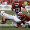 OU\'s Tony Jefferson (1) and Tony Jefferson (1) bring down UT\'s David Ash (14) during the Red River Rivalry college football game between the University of Oklahoma (OU) and the University of Texas (UT) at the Cotton Bowl in Dallas, Saturday, Oct. 13, 2012. Photo by Bryan Terry, The Oklahoman