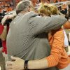 OSU head coach Jim Littell hugs Shelley Budke, widow of former OSU head coach Kurt Budke, after the Women\'s NIT championship college basketball game between Oklahoma State University and James Madison at Gallagher-Iba Arena in Stillwater, Okla., Saturday, March 31, 2012. Kurt Budke and three others were killed in a plane crash on a recruiting trip in November of 2011. OSU won, 75-68. Photo by Nate Billings, The Oklahoman
