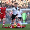 Photo - Fulham's Scott Parker, center, and Southampton's Victor Wanyama, below, battle for possession of the ball during their English Premier League soccer match at Craven Cottage, London, Saturday, Feb. 1, 2014. (AP Photo/John Walton, PA Wire)   UNITED KINGDOM OUT  -  NO SALES  -  NO ARCHIVES