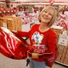 Shopper Leah Carver of Paden buys candy at Russell Stover in Moore, Okla. Friday, of Feb. 13, 2009. She isn\'t sure yet who will get the big box, but she is buying for family and friends. Photo by Steve Sisney, The Oklahoman
