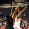 Clemson\'s Nikki Dixon (21) shoots a jumper over Duke\'s Elizabeth Williams during the second half of an NCAA college basketball game, Thursday, Jan. 24, 2013, at Littlejohn Coliseum in Clemson, S.C. Duke won 60-46. (AP Photo/Richard Shiro)