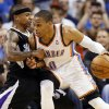 Oklahoma City\'s Russell Westbrook (0) works against Sacramento\'s Isaiah Thomas (22) during an NBA basketball game between the Oklahoma City Thunder and the Sacramento Kings at Chesapeake Energy Arena in Oklahoma City, Monday, April 15, 2013. Oklahoma City won, 104-95. Photo by Nate Billings, The Oklahoman