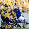 Kansas\' James Sims (29) is tackled by West Virginia\'s Darwin Cook (25) during the second quarter of their NCAA college football game in Morgantown, W.Va., on Saturday, Dec. 1, 2012. (AP Photo/Christopher Jackson)
