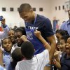 Photo - Oklahoma City's Russell Westbrook greets children during a Thanksgiving dinner at the Boys & Girls Club of Oklahoma County in Oklahoma CIty,  Tuesday, Nov. 20, 2012. Photo by Sarah Phipps, The Oklahoman