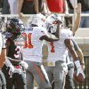Oklahoma State Cowboys wide receiver Justin Blackmon (81) and Joseph Randle (1) celebrate a touchdown next to Texas Tech Red Raiders cornerback Eugene Neboh (31) during the college football game between the Oklahoma State University Cowboys (OSU) and Texas Tech University Red Raiders (TTU) at Jones AT&T Stadium on Saturday, Nov. 12, 2011. in Lubbock, Texas. Photo by Chris Landsberger, The Oklahoman ORG XMIT: KOD