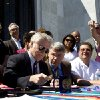 Oregon Gov. John Kitzhaber signs Senate Bill 833 into law on the steps of the State Capitol in Salem, Ore. on Wednesday, May 1, 2013. The bill authorizes driver\'s cards for those without the documents to obtain regular driver\'s licenses. (AP Photo/The Oregonian, Beth Nakamura)