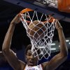 Oklahoma City\'s Hasheem Thabeet (34) dunks the ball during the NBA basketball game between the Oklahoma City Thunder and the Memphis Grizzlies at the Chesapeake Energy Arena in Oklahoma City, Thursday, Jan. 31, 2013.Photo by Sarah Phipps, The Oklahoman