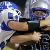 Deer Creek\'s Austin Loomis tackles Guthrie\'s Bryan Dutton during the high school football game between Guthrie and Deer Creek at Guthrie, Thursday, Oct. 18, 2012. Photo by Sarah Phipps, The Oklahoman