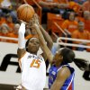 Oklahoma State\'s Toni Young (15) shoots the ball over Kansas\' Chelsea Gardner (15) during a women\'s college basketball game between Oklahoma State University (OSU) and Kansas at Gallagher-Iba Arena in Stillwater, Okla., Tuesday, Jan. 8, 2013. Photo by Bryan Terry, The Oklahoman