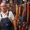 Photo - GUN SALES: Roy Hawkins next to a gun rack in his store, R & S Gun Service and Supply, in Moore Friday, Nov. 7, 2008. PHOTO BY DOUG HOKE THE OKLAHOMAN. ORG XMIT: KOD