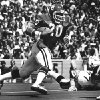 Billy Sims, University of Oklahoma (OU) college football player: University of Oklahoma running back Billy Sims picks up yardage against the visiting Iowa Hawkeyes as the Sooners prevailed 21-6 in Norman. Staff photo by Todd James taken 9/15/77.