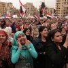 Protesters chant slogans and wave national flags in Tahrir Square in Cairo, Egypt, Tuesday, Dec. 4, 2012. Hundreds of black-clad riot police deployed around the Itihadiya palace in Cairo\'s district of Heliopolis. Barbed wire was also placed outside the complex, and side roads leading to it were blocked to traffic. Protesters gathered at Cairo\'s Tahrir square and several other points not far from the palace to march to the presidential complex. (AP Photo/Maya Alleruzzo)