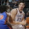 Byron Mullens (23) of Oklahoma City tries to dribble around Jordan Hill (43) of New York during the NBA basketball game between the Oklahoma City Thunder and the New York Knicks at the Ford Center in Oklahoma City, Monday, January 11, 2010. Oklahoma City won, 106-88. Photo by Nate Billings, The Oklahoman