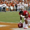 OU\'s Jamarkus McFarland (97) kneels in prayer during the Red River Rivalry college football game between the University of Oklahoma (OU) and the University of Texas (UT) at the Cotton Bowl in Dallas, Saturday, Oct. 13, 2012. Photo by Chris Landsberger, The Oklahoman