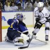 Photo -   Los Angeles Kings' Anze Kopitar, of Slovenia, scores past St. Louis Blues goalie Brian Elliott, left, during the first period in Game 2 of an NHL hockey Stanley Cup second-round playoff series, Monday, April 30, 2012, in St. Louis. (AP Photo/Jeff Roberson)