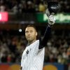 Photo - FILE - In this Sept. 11, 2009 file photo, New York Yankees' Derek Jeter waves to the crowd after hitting a single to pass Lou Gehrig's all-time Yankees hit record during the third inning of a baseball game in New York.  Jeter says he will retire after this season. Jeter posted a long letter on his Facebook account Wednesday, Feb. 12, 2014,  saying the 2014 will be his last year playing professional baseball.(AP Photo/Frank Franklin II, File)