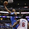 Photo - Oklahoma City Thunder guard Russell Westbrook goes to the basket as Los Angeles Clippers center DeAndre Jordan watches during the first half of an NBA basketball game in Los Angeles, Wednesday, April 9, 2014. (AP Photo/Danny Moloshok)