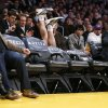 Photo - Los Angeles Lakers' Steve Blake falls over empty courtside chairs as he tries to save a ball from going out of bounds against the Phoenix Suns during the first half of an NBA basketball game on Tuesday, Feb. 12, 2013, in Los Angeles. (AP Photo/Danny Moloshok)