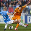 Photo - Real Madrid's Angel Di Maria from Argentina, right, in action with CF Malaga's Nordin Amrabat, from Morocco during a Spanish La Liga soccer match at La Rosaleda stadium in Malaga, Spain, Saturday March 15, 2014. (AP Photo/Daniel Tejedor)