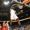 Photo - Miami Heat small forward LeBron James (6) dunks in the first period of an NBA basketball game against the Miami Heat in Atlanta, Monday, Jan. 20, 2014. (AP Photo/Todd Kirkland)