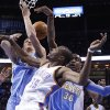 Photo - Oklahoma City Thunder forward Kevin Durant (35) loses the ball under the basket in front of Denver Nuggets center Timofey Mozqov (25) and forward Quincy Miller (30) in the first quarter of an NBA basketball game in Oklahoma City, Monday, March 24, 2014. (AP Photo/Sue Ogrocki)