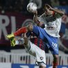 Photo - Derlis Orue, right, of Paraguay's Nacional fights for the ball with Nestor Ortigoza of Argentina's San Lorenzo during the Copa Libertadores final soccer match in Buenos Aires, Argentina, Wednesday, Aug. 13, 2014. (AP Photo/Natacha Pisarenko)
